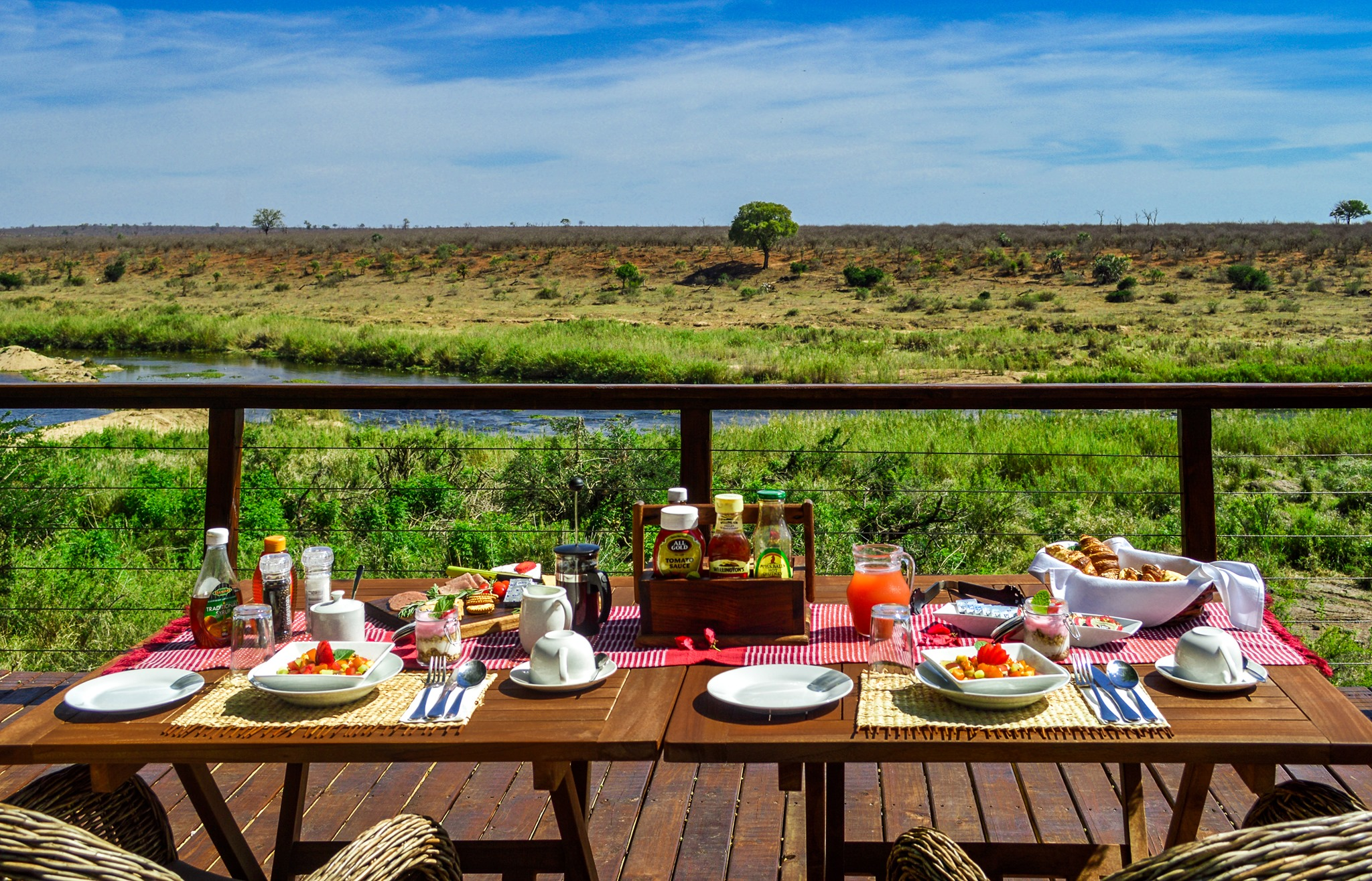 Breakfast spread with a view from the deck at Bucklers Africa Lodge