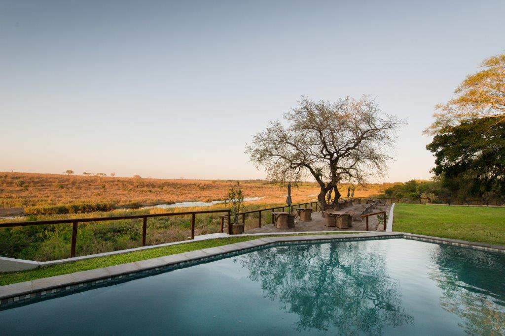 Bucklers Africa Lodge swimming pool and garden with view of Kruger National Park